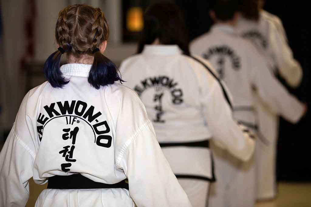 Black belts line up to do poomse